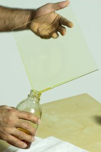 Pouring off excess collodion